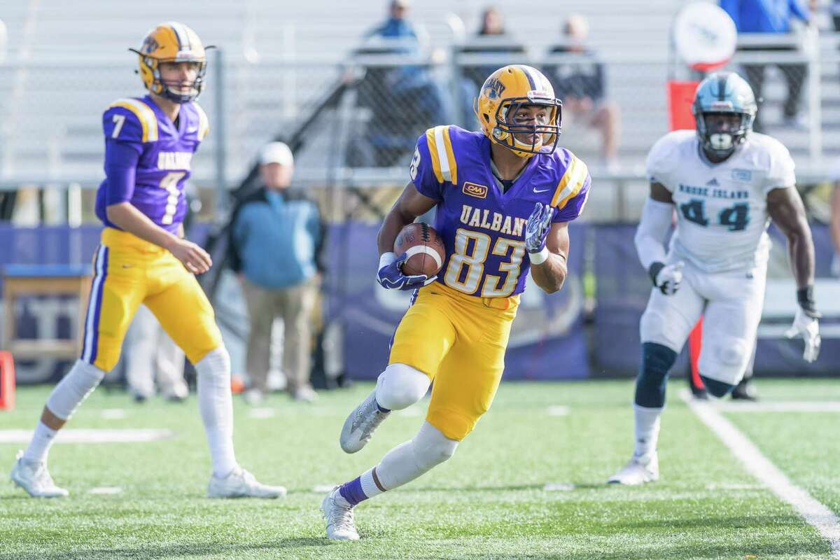 UAlbany receiver Donovan McDonald turns upfield for positive yards during the first half of the Rhode Island vs. UAlbany game on Saturday, Oct. 28, 2017. The visiting Rams defeated the Great Danes 31-14. (Bill Ziskin / UAlbany Athletics)