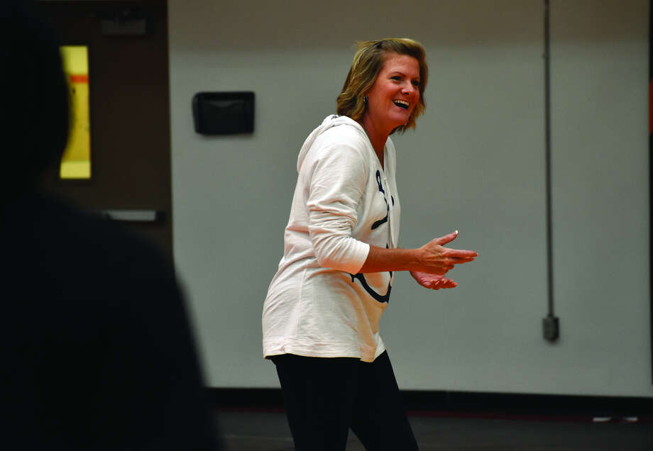 EHS girls' volleyball coach Lisa Orlet laughs during the second day of practice for the Tigers. Photo: Matthew Kamp