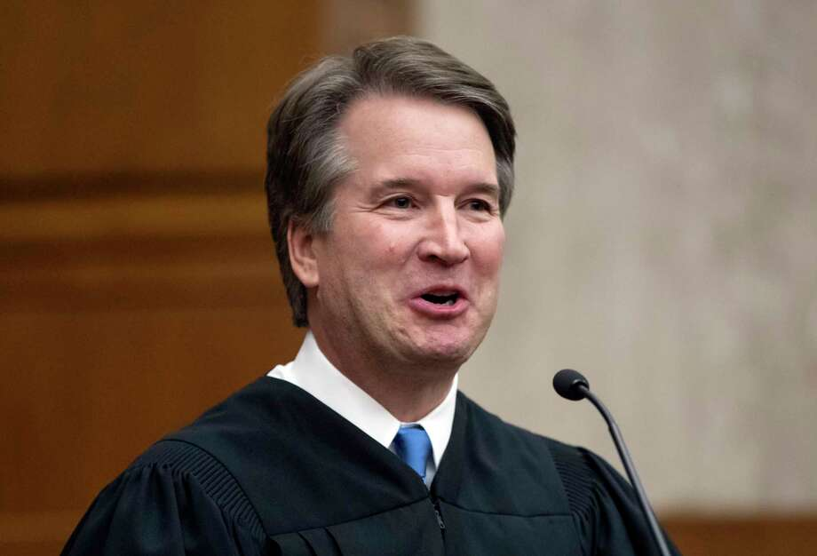 In this Aug. 7, 2018, photo. President Donald Trump's Supreme Court nominee, Judge Brett Kavanaugh, officiates at the swearing-in of Judge Britt Grant to take a seat on the U.S. Court of Appeals for the Eleventh Circuit in Atlanta at the U.S. District Courthouse in Washington. The Senate will begin a confirmation hearing for Kavanaugh on Sept. 4, the Sen. check Grassley, R-Iowa, the chairman of the Judiciary Committee says.(AP Photo/J. Scott Applewhite) Photo: J. Scott Applewhite / Copyright 2018 The Associated Press. All rights reserved