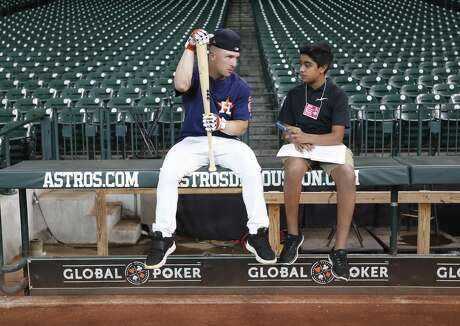 Houston Astros Alex Bregman is interviewed by Jaisal Kalapatapu, 13, of Katy, for SI for Kids magazine during batting practice before the start of an MLB game at Minute Maid Park, Friday, August 10, 2018, in Houston. Photo: Karen Warren/Houston Chronicle