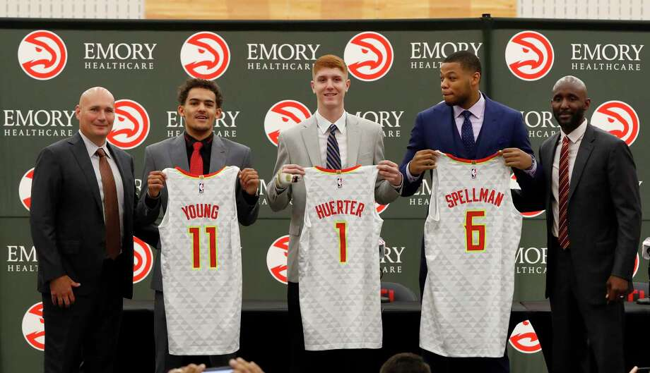 Atlanta Hawks NBA basketball team first-round draft picks, Trae Young (11), Kevin Huerter (1) and Omari Spellman (6) poses with general manager Travis Shlenk, left, and head coach Lloyd Pierce during a news conference Monday, June 25, 2018, in Atlanta.(AP photo/John Bazemore) Photo: John Bazemore / Copyright 2018 The Associated Press. All rights reserved.