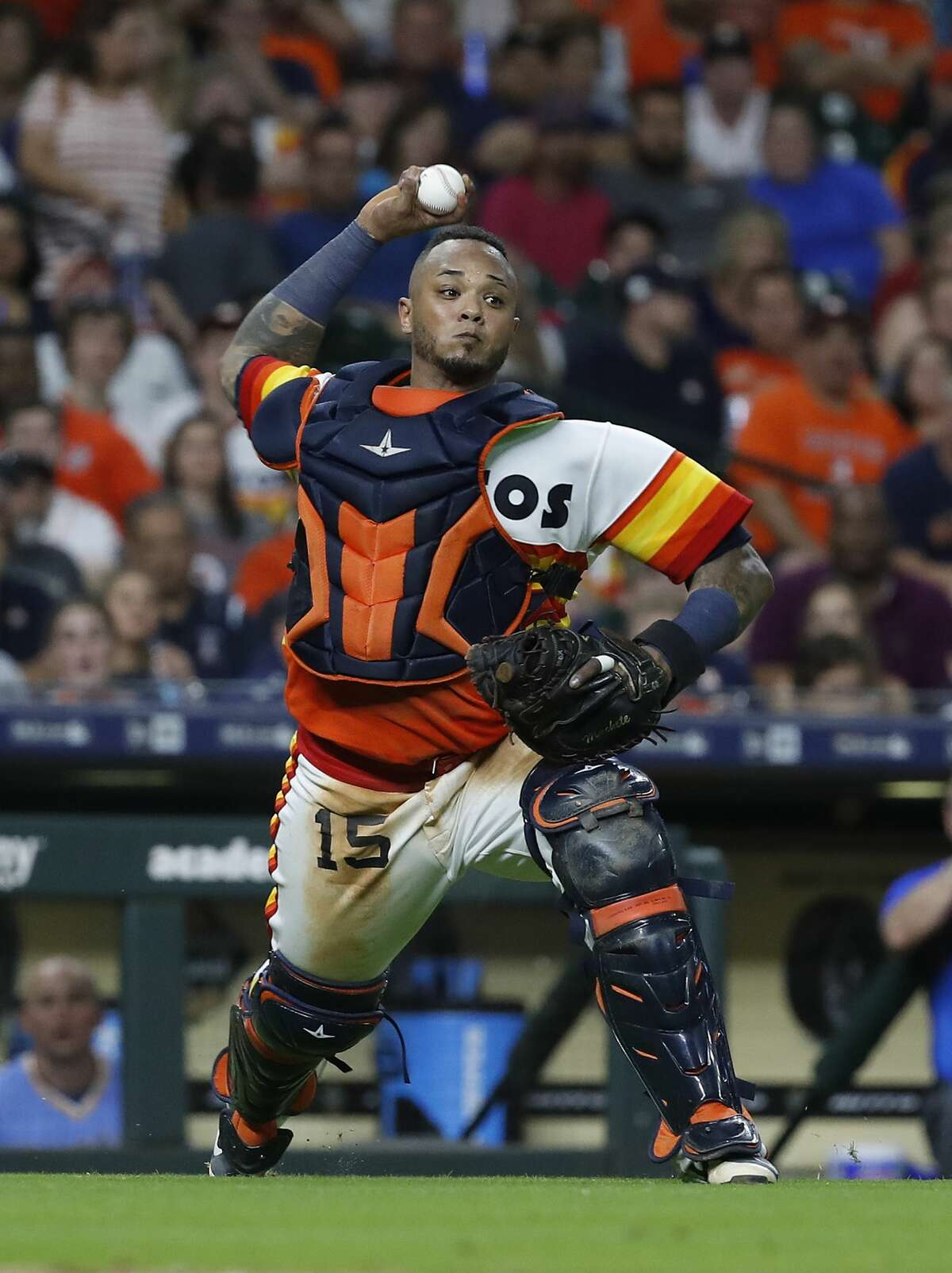 Houston Astros catcher Martin Maldonado (15) makes the throw to first base as Seattle Mariners Dee Gordon bunt grounded out during the eighth inning of an MLB game at Minute Maid Park, Friday, August 10, 2018, in Houston.
