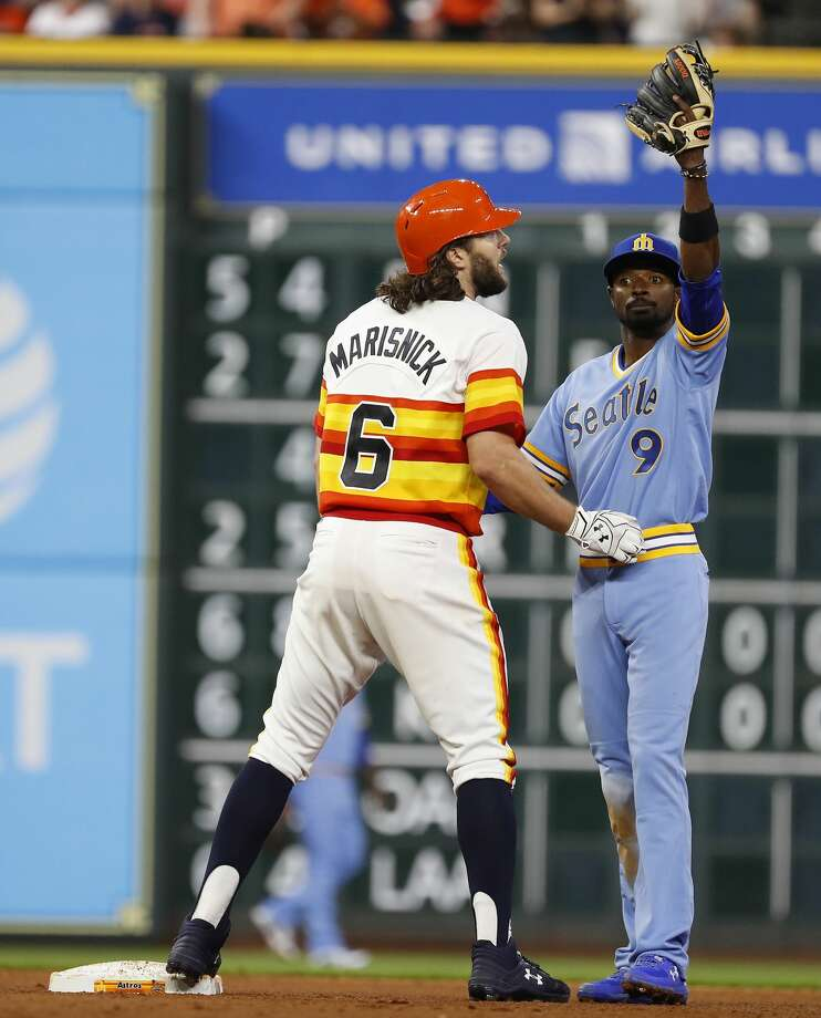 Seattle Mariners Dee Gordon (9) signals for a trainer for Houston Astros Jake Marisnick (6) who was injured after hitting a double during the seventh inning of an MLB game at Minute Maid Park, Friday, August 10, 2018, in Houston. Photo: Karen Warren/Houston Chronicle