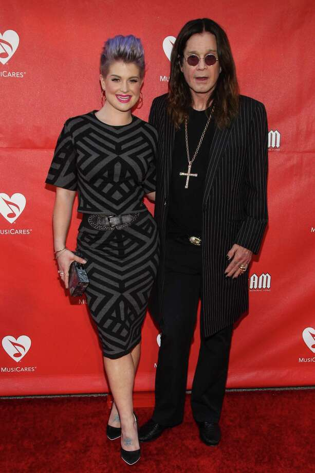 Kelly Osborne, left, and Ozzy Osbourne attend the 10th annual MusiCares MAP Fund Benefit Concert at Club Nokia on Monday, May 12, 2014 in Los Angeles. (Photo by Paul A. Hebert/Invision/AP) ORG XMIT: CAPH101 Photo: Paul A. Hebert / Invision