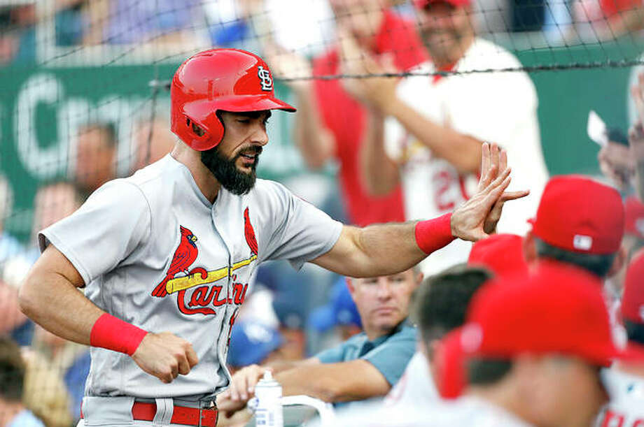 The Cardinals' Matt Carpenter is congratulated at the dugout after hitting a two-run home run in the second inning of Friday night's game against the Kansas City Royals in Kansas City. Photo:       AP