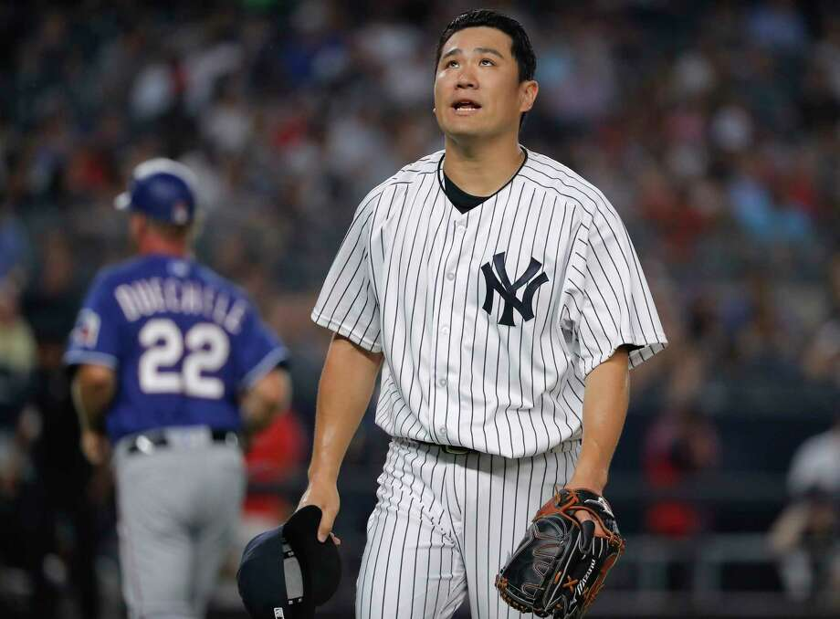 New York Yankees starting pitcher Masahiro Tanaka walks off the field at the end of the top of the fourth inning of a baseball game against the Texas Rangers, Friday, Aug. 10, 2018, in New York. (AP Photo/Julie Jacobson) Photo: Julie Jacobson / Copyright 2018. The Associated Press. All Rights Reserved.