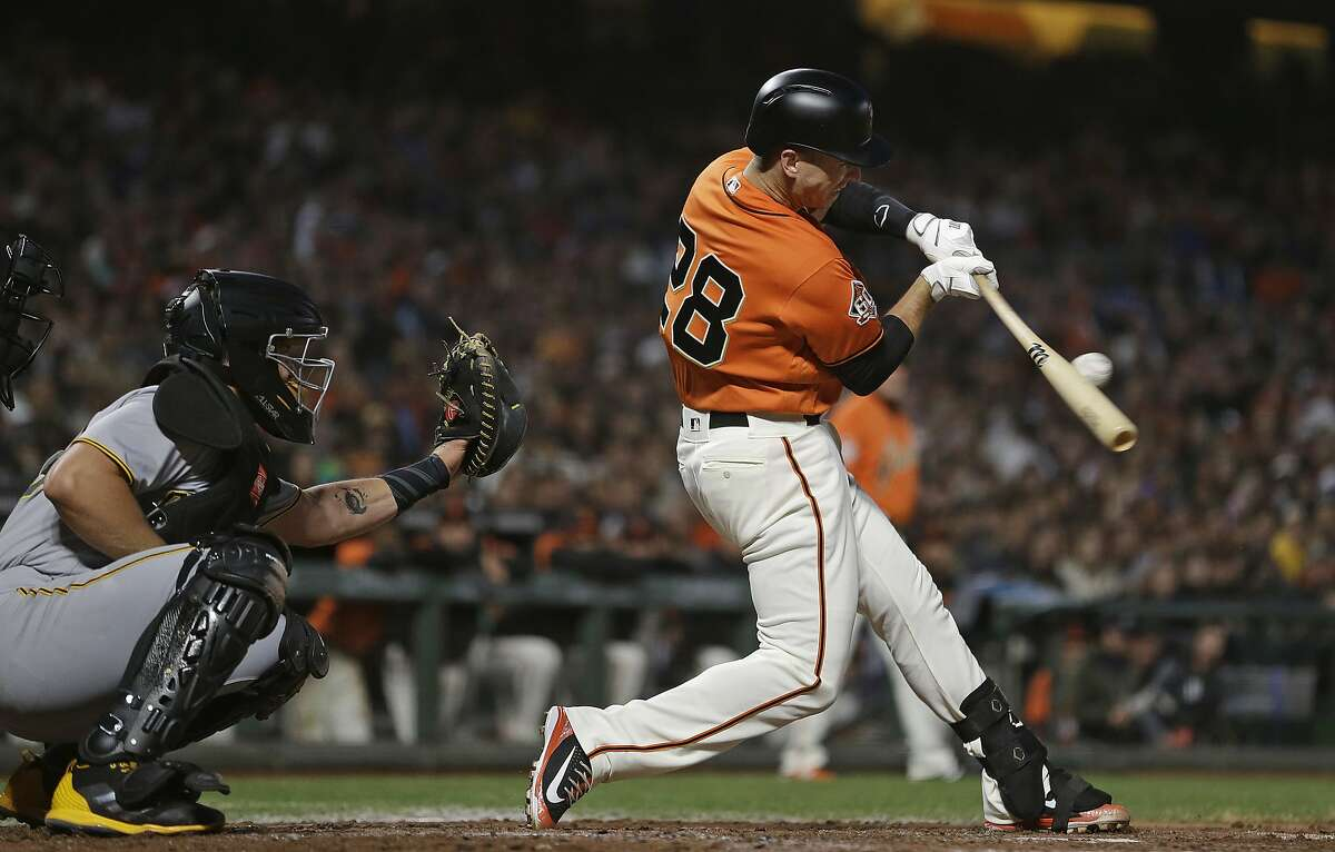 San Francisco Giants' Buster Posey hits a two-run single off Pittsburgh Pirates starting pitcher Clay Holmes during the third inning of a baseball game Friday, Aug. 10, 2018, in San Francisco. (AP Photo/Eric Risberg)