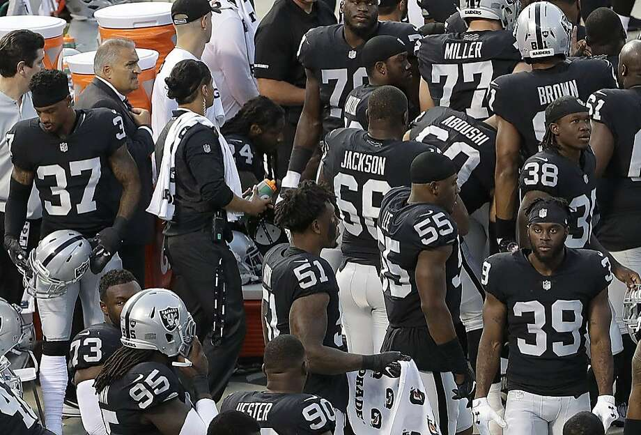 Oakland Raiders running back Marshawn Lynch, center left, sits near the sideline just before the national anthem at an NFL preseason football game between the Raiders and the Detroit Lions in Oakland, Calif., Friday, Aug. 10, 2018. Lynch remained seated for the anthem. (AP Photo/Jeff Chiu) Photo: Jeff Chiu / Associated Press