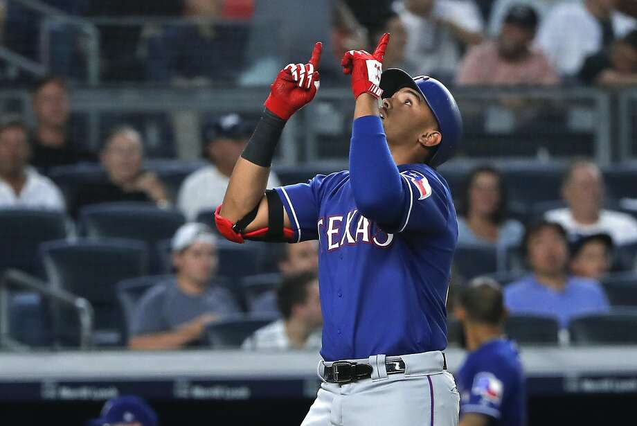 Texas rookie Ronald Guzman reacts as he crosses the plate after hitting a solo home run against the New York Yankees during the fourth inning of a baseball game Friday, Aug. 10, 2018, in New York. (AP Photo/Julie Jacobson) Photo: Julie Jacobson / Associated Press