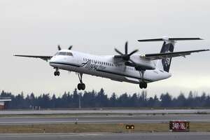 A Bombardier Dash 8 operated by Alaska Airlines Horizon Air takes off Tuesday, Jan. 26, 2016, at Seattle-Tacoma International Airport in Seattle. (AP Photo/Ted S. Warren)