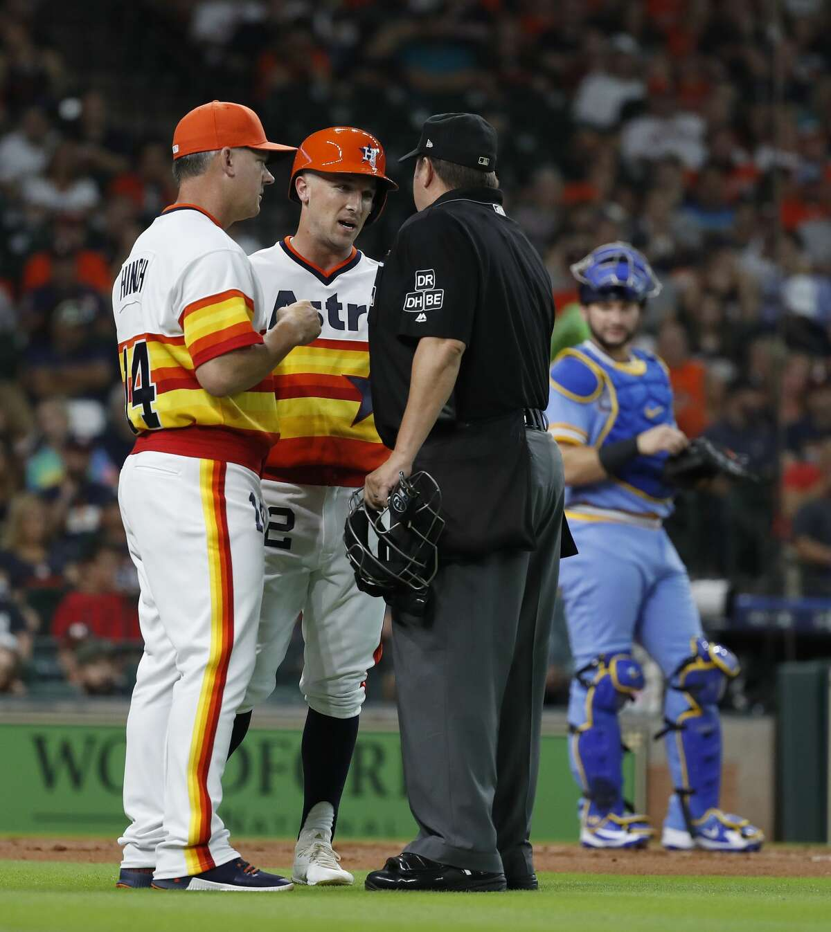 Houston Astros manager AJ Hinch (14) argues with home plate umpire Doug Eddings that Houston Astros Alex Bregman (2) fouled a ball off his foot during the first inning of an MLB game at Minute Maid Park, Friday, August 10, 2018, in Houston.