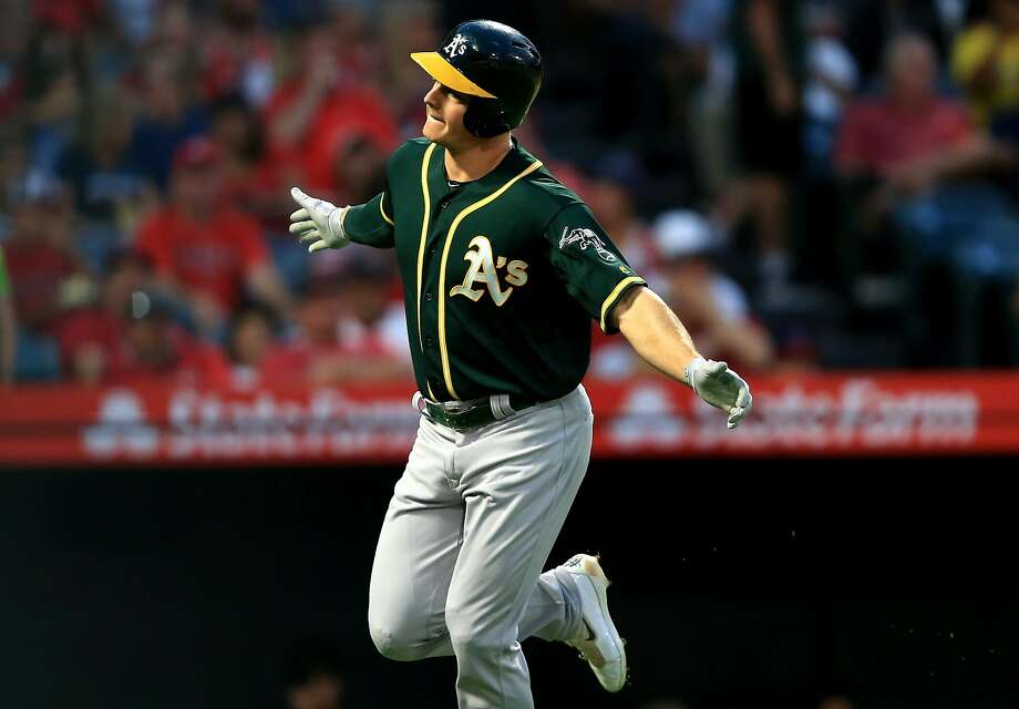 ANAHEIM, CA - AUGUST 10:  Matt Chapman #26 of the Oakland Athletics reacts after hitting a solo homerun during the first inning of a game against the Los Angeles Angels of Anaheim at Angel Stadium on August 10, 2018 in Anaheim, California.  (Photo by Sean M. Haffey/Getty Images) Photo: Sean M. Haffey / Getty Images