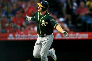 ANAHEIM, CA - AUGUST 10:  Matt Chapman #26 of the Oakland Athletics reacts after hitting a solo homerun during the first inning of a game against the Los Angeles Angels of Anaheim at Angel Stadium on August 10, 2018 in Anaheim, California.  (Photo by Sean M. Haffey/Getty Images)