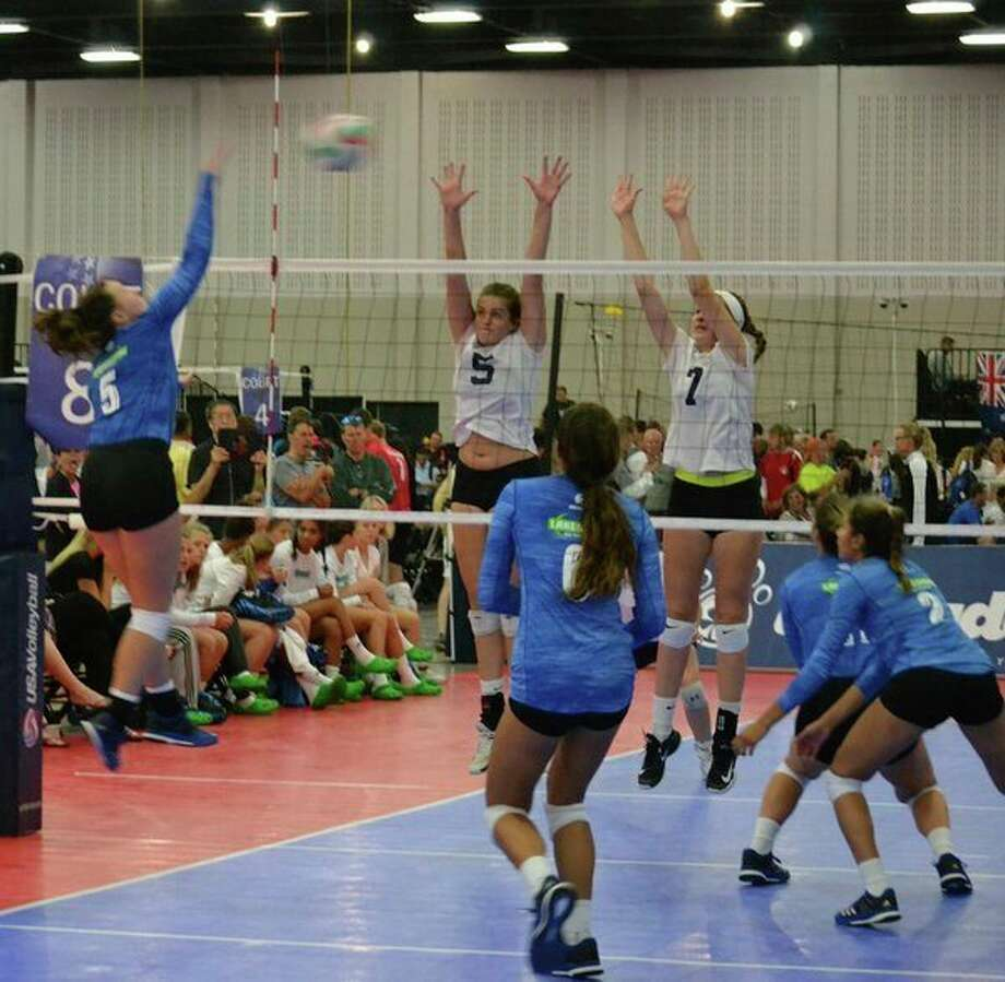 Isabel Velasquez, left, spikes the ball during the USA Volleyball High Performance Championships in Tulsa, Okla., in late July. (Photo provided by Isabel Velasquez)