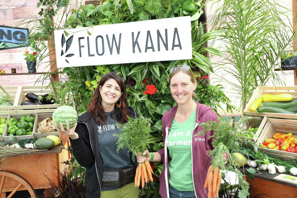 Cate Powers, left, head of communications at Flow Kana and Amber O'Neill, farmer at HappyDay Farms, at Grass Lands.