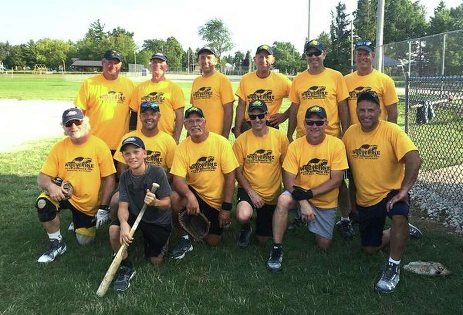 Wolverine Auto Brokers won the Old Timers Tournament. Pictured are, front row, bat boy John Robinson; middle row, Dan Braden, Tom Robinson, Dave Dombowski, Barry Albrecht, Brad Braden and Kurt Messing; back row, Dennis Hanson, Tim Rutkowski, Dan Guza, Vinnie Messing, Dan Ritter and Erik Lundy. (Submitted Photo)