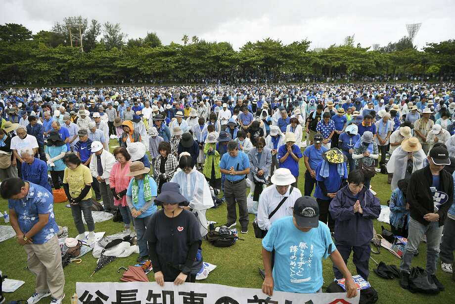 Okinawans pay tribute to Gov. Takeshi Onaga, who died last week, during a rally in Naha. Onaga had spearheaded opposition to the relocation of the U.S. Marine base to a coastal site. Photo: Yohei Nishimura / Kyodo News
