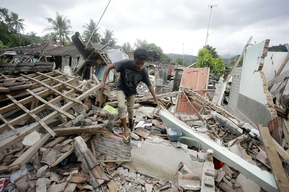 A man walks through debris from Sunday's earthquake in West Lombok, Indonesia, Saturday, Aug. 11, 2018. Scientist say the powerful Indonesia earthquake that killed more than 300 people lifted the island it struck by as much as 25 centimeters (10 inches). (AP Photo/Firdia Lisnawati) Photo: Firdia Lisnawati, Associated Press