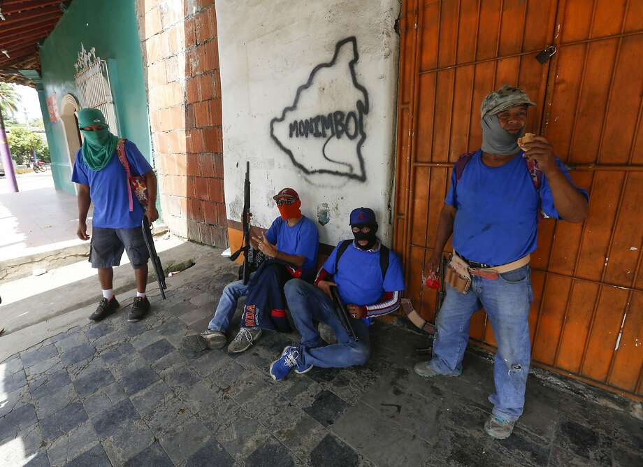Armed pro-government militia members patrol in Masaya, Nicaragua, in July. More than 2,000 people have been arrested in the recent security crackdown. Photo: Alfredo Zuniga / Associated Press
