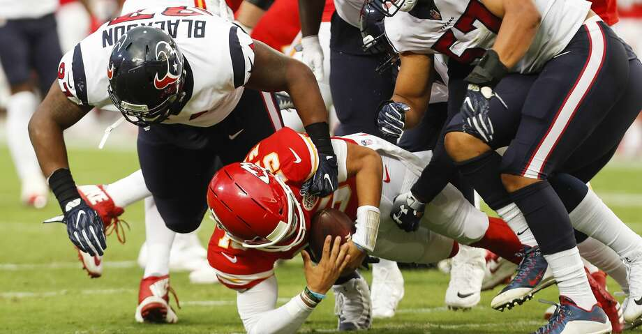 PHOTOS: Texans training camp Houston Texans defensive end Angelo Blackson (97) and  linebacker Brennan Scarlett (57) sack Kansas City Chiefs quarterback Patrick Mahomes (15) during the first quarter of an NFL football game a Arrowhead Stadium on Thursday, Aug. 9, 2018, in Kansas City. Browse through the photos to see action from the Texans' return to camp at the Methodist Training Center. Photo: Brett Coomer/Houston Chronicle