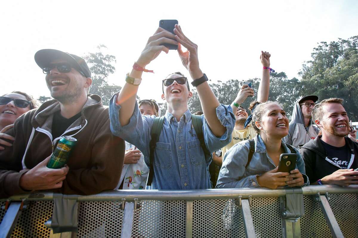 Audience members react to Carly Rae Jepsen performing at the Twin Peaks stage at Outside Lands Music Festival on Friday, August, 2018 in San Francisco, Calif.