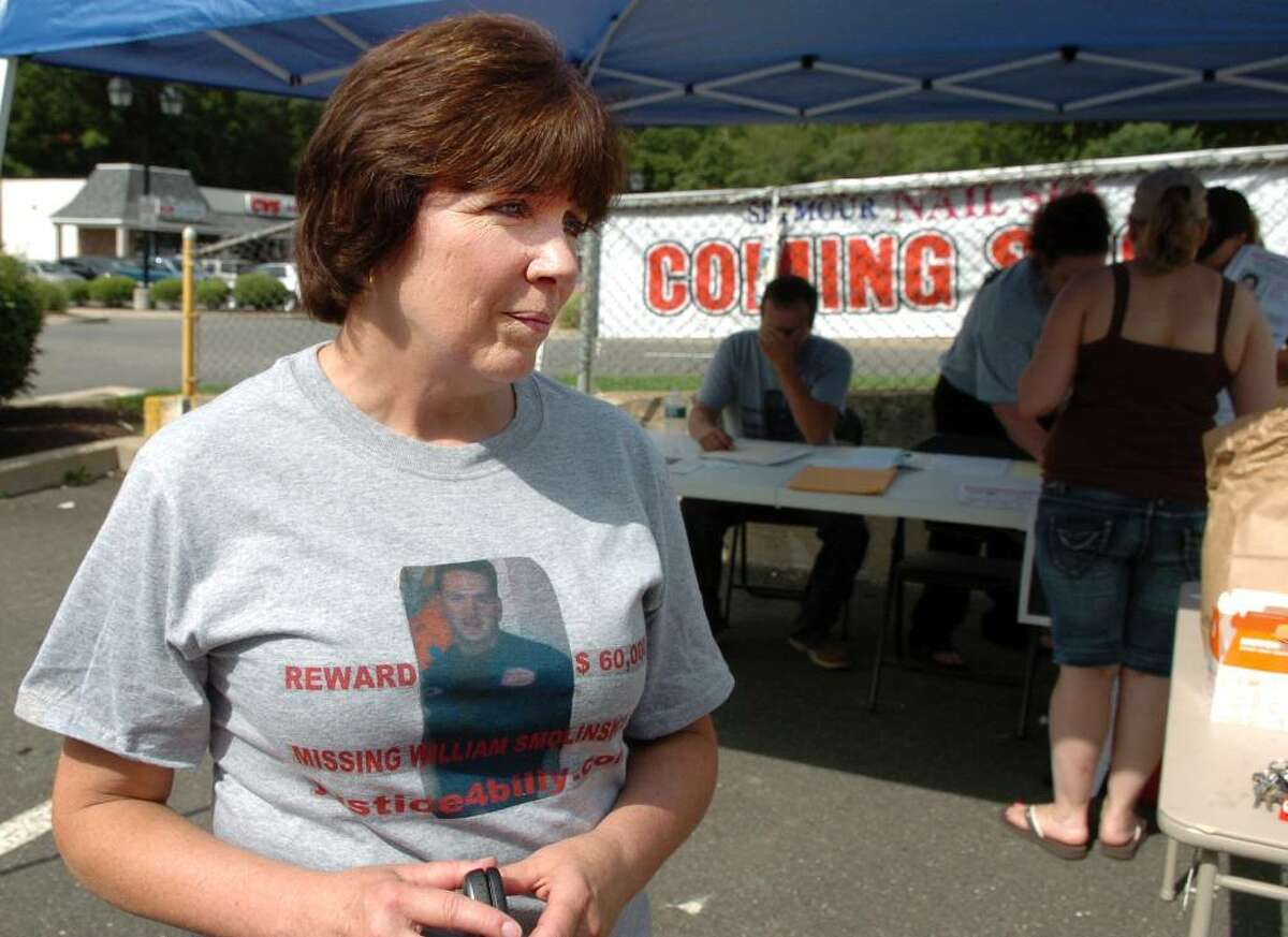 Janice Smolinski, the mother of William Smolinski who was last seen in 2004, coordinates volunteer efforts to spread awareness about the continued search efforts for her son Saturday July 10, 2010 at Klarides Village Plaza in Seymour. Volunteers distributed flyers at local businesses throughout the Valley.