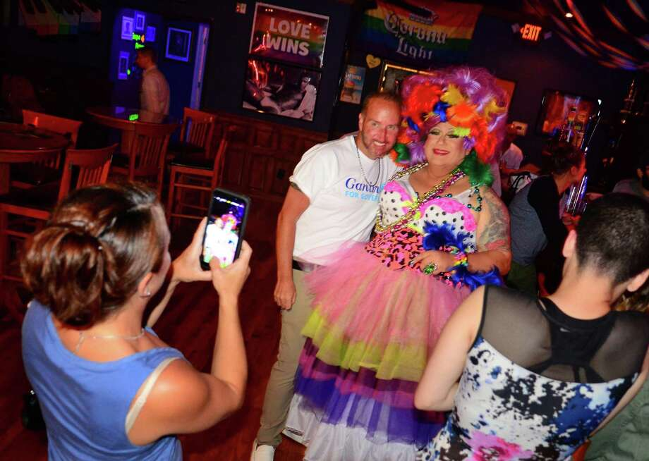 Joe Ganim supporter Robert Rickard poses for a photo with drag performer Dolores Degage at Trevi Lounge during the Drag Race for Governor fundraiser in Fairfield, Conn., on Friday, Aug. 10, 2018. Friday's fundraiser, hosted by Dolores Degage, comes just days before Democrats decide in Tuesday's gubernatorial primary between Ganim or the endorsed candidate, millionaire businessman Ned Lamont. Photo: Christian Abraham / Hearst Connecticut Media / Connecticut Post