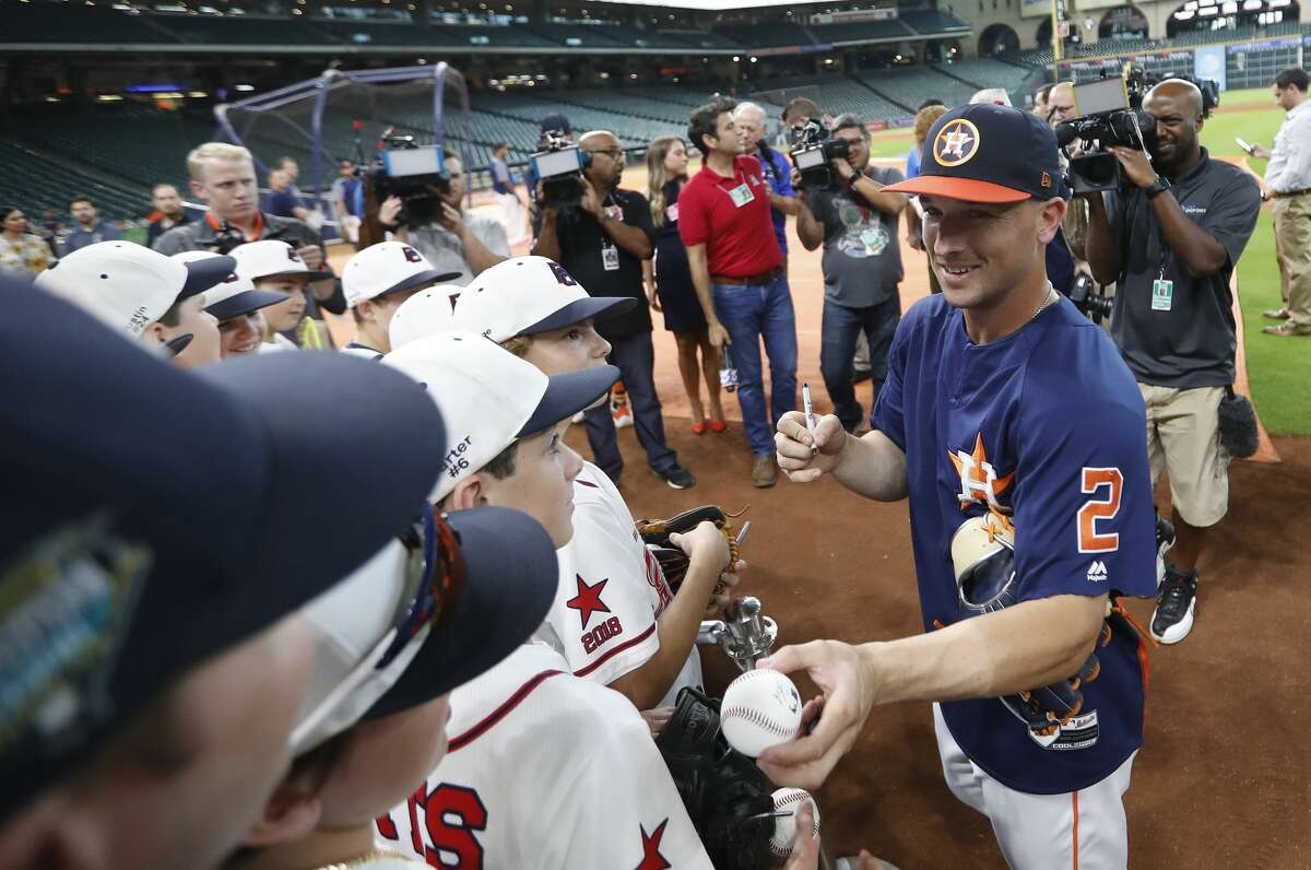 Houston Astros Alex Bregman greets members of the Post Oak Little League before they head to the Little League World Series during batting practice before the start of an MLB game at Minute Maid Park, Friday, August 10, 2018, in Houston.