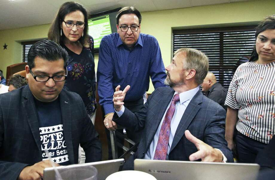 Former U.S. Rep. Pete Gallego hears early results with his wife Maria Elena as he meets with his supporters at an election night party the Taqueria Mexico restaurant on Somerset Rd. on July 31, 2018.  Campaign workers Robert Vargas III (left) and Christian Archer announce returns streaming in onto their laptops. Photo: Tom Reel, Staff / Staff Photographer / 2017 SAN ANTONIO EXPRESS-NEWS