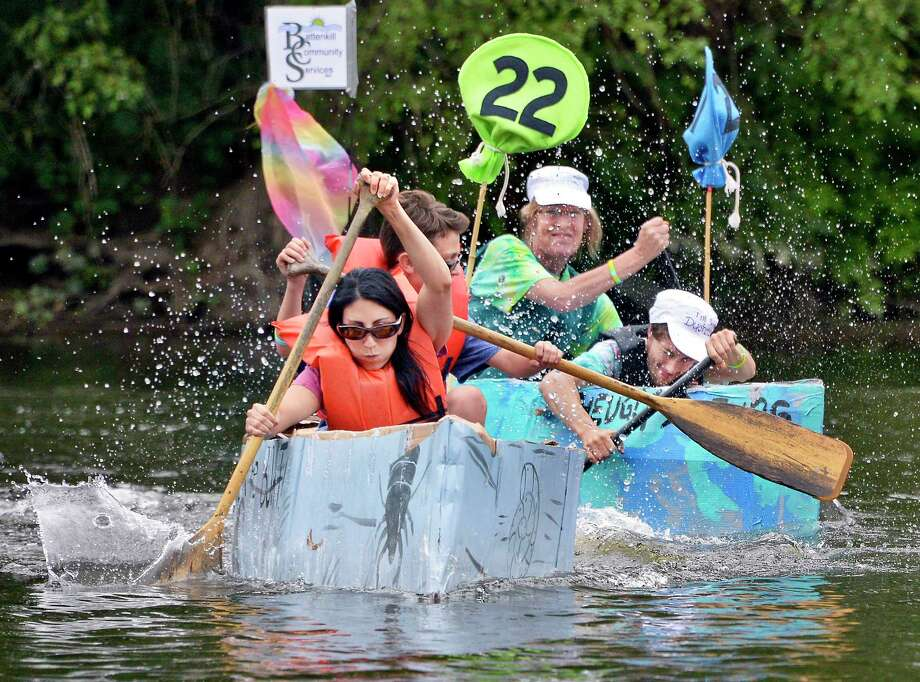 Rock the Boat's Trish Bendon, left, and son Parker edge out the Battenkill Community Services' Ugly Ductling boat paddled by Carole Liggett and Thomas Gogan, right, during the Annual Cardboard Boat Races at Fort Hardy Park beach Saturday August 11, 2018 in Schuylerville, NY.  (John Carl D'Annibale/Times Union) Photo: John Carl D'Annibale / 20044379A