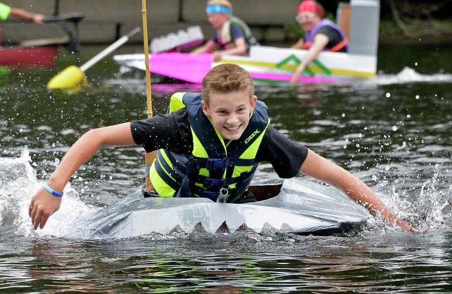 Fourteen-year-old Ted Schwerd of Schuylerville uses his hands to paddle during the Annual Cardboard Boat Race at Fort Hardy Park beach Saturday August 11, 2018 in Schuylerville, NY.  (John Carl D'Annibale/Times Union) Photo: John Carl D'Annibale / 20044379A