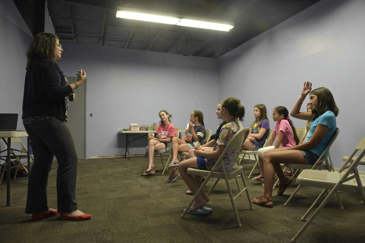 Courtney Lauria, from the Danbury Woman's Center, leads a discussion with 6th to 8th grade gymnasts about consent. Gymnast Warriors, a group begun by Lauren Candee, of Redding, is acting as a go-between with woman's centers to talk to gymnasts. Wednesday, August 8, 2018, at Gymnastics Revolution in Danbury, Conn.