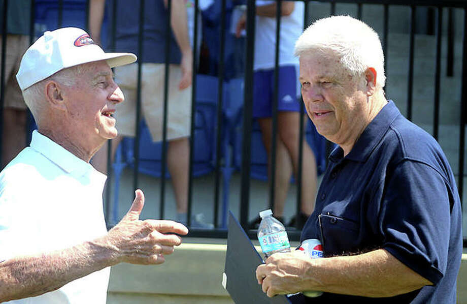 Former Florissant Valley Community College soccer coach Pete Sorber, left, and LCCC coach Tim Rooney talk Saturday following a ceremony naming the LCCC soccer stadium as Tim Rooney Stadium. Rooney played for Sorber at Flo Valley, where Sorber won 10 NJCAA championships. Photo:       Pete Hayes | The Telegraph