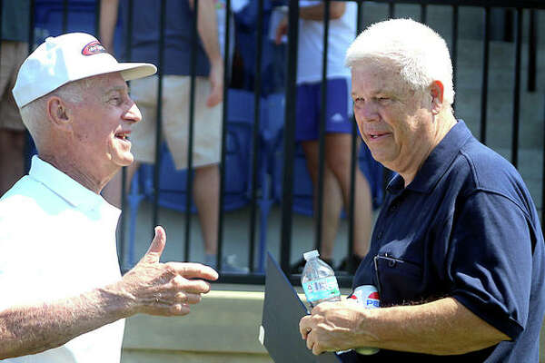 Former Florissant Valley Community College soccer coach Pete Sorber, left, and LCCC coach Tim Rooney talk Saturday following a ceremony naming the LCCC soccer stadium as Tim Rooney Stadium. Rooney played for Sorber at Flo Valley, where Sorber won 10 NJCAA championships.