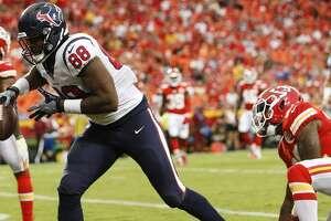 Houston Texans tight end Jordan Akins (88) celebrates his 14-yard touchdown reception against Kansas City Chiefs defensive back Robert Golden (22) during the second quarter of an NFL football game a Arrowhead Stadium on Thursday, Aug. 9, 2018, in Kansas City.
