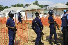 Police officers stand guards at a newly established Ebola response center in Beni, Democratic Republic of Congo, Friday, Aug. 10, 2018. The World Health Organization's director-general says instability, high population density and large displacement in Congo's east mean the response to the nation's tenth Ebola virus outbreak must be stronger than ever before. (AP Photo/Al-hadji Kudra Maliro)