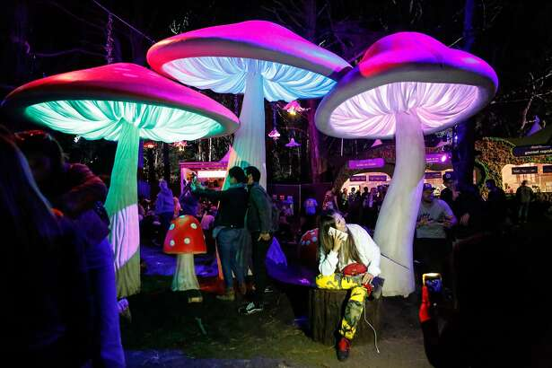 People take pictures at gigantic mushrooms in the Grand Artique area at Outside Lands Music Festival on Friday, August, 2018 in San Francisco, Calif.