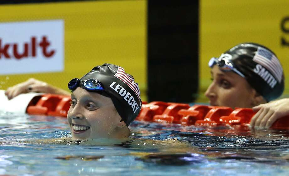 Former Stanford swimmer Katie Ledecky (left) smiles after winning the women's 400-meter freestyle final at the Pan Pacifics in Tokyo. Teammate Leah Smith (right) finished third. Photo: Koji Sasahara / Associated Press