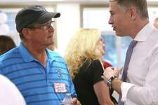 Republican gubernatorial candidate David Stemerman, right, talks with Jack Gedney during an ice cream social at Burlington Public Library in Burlington on Thursday night, August 9, 2018.