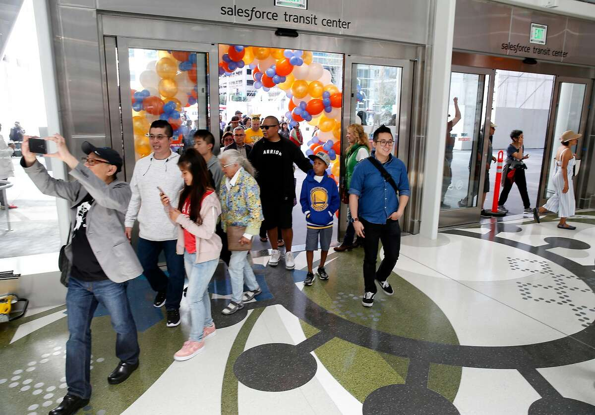 The first of thousands of visitors waiting in line to attend the grand opening stream into the Salesforce Transit Center when the doors were opened in San Francisco, Calif. on Saturday, Aug. 11, 2018. Buses begin rolling through the terminal Sunday.