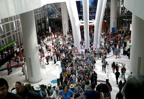 Thousands of visitors attending the grand opening line up to ride the escalators to tour the Salesforce Transit Center in San Francisco, Calif. on Saturday, Aug. 11, 2018. Buses begin rolling through the terminal Sunday.