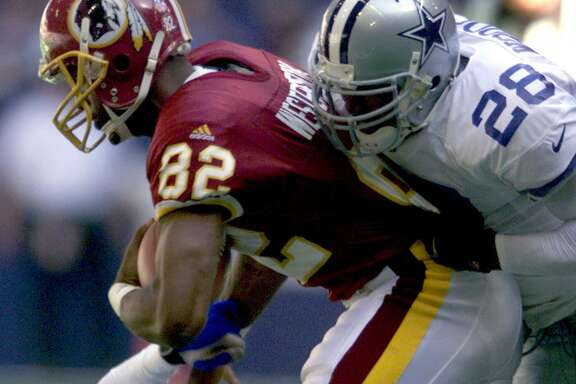 SPORTS / ADVANCE FOR SUN 09 24 00 / FOR TRAVIS TINGLE - Cowboys Darren Woodson(28) brings down the Redskins Michael Westbrook(82) during Sundays game in Dallas. PHOTO BY EDWARD A. ORNELAS 10-24-99