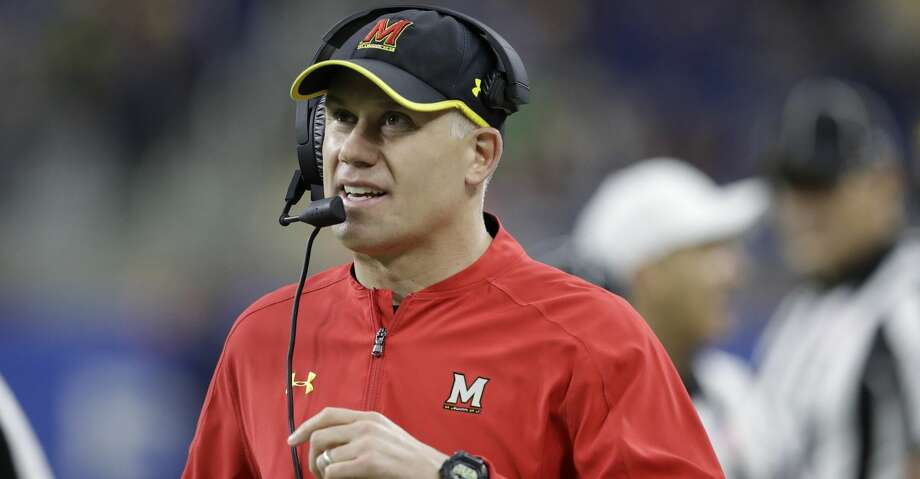 FILE - In this Dec. 26, 2016, file photo, Maryland head coach DJ Durkin walks the sideline during the first half of the Quick Lane Bowl NCAA college football game against Boston College in Detroit. Maryland placed the head of the football team's strength and conditioning staff on paid leave while it investigates claims he verbally abused and humiliated players, a person briefed on the situation said. The person spoke to The Associated Press on Saturday, Aug. 11, 2018, on condition of anonymity because Maryland had not announced the decision regarding Rick Court. The person says athletic director Damon Evans spoke with the football team Saturday morning and Durkin was still leading the program.  (AP Photo/Carlos Osorio, File) Photo: Carlos Osorio/Associated Press