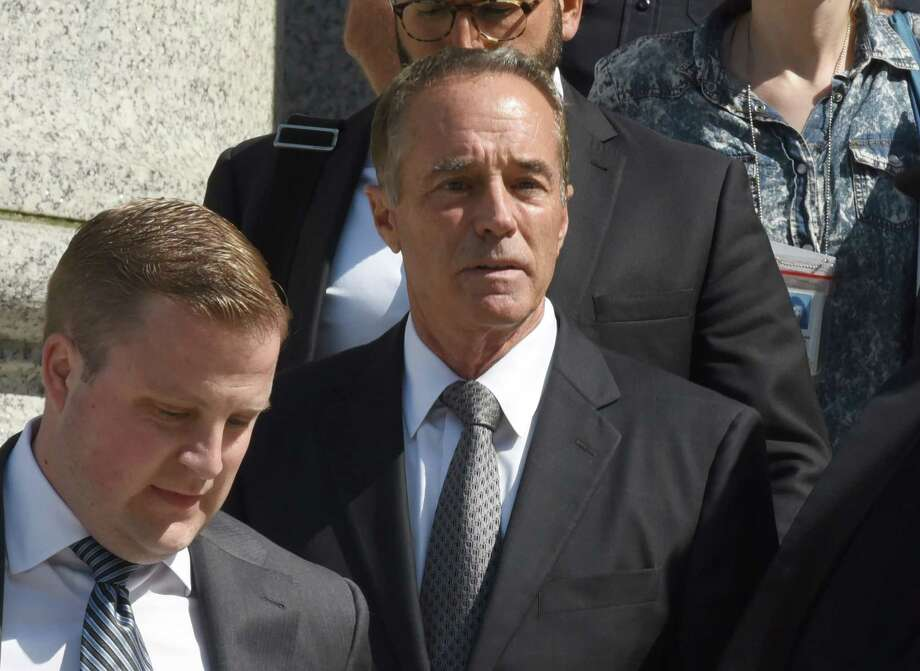 (FILES) In this file photo taken on August 8, 2018 (L), US Representative Chris Collins, Republican from New York, leaves US Federal Court in New York on after being indicted on insider trading. - Collins reversed course on August 11, 2018, saying he will end his re-election campaign. Collins, who is loyal to President Donald Trump, was arrested and charged this week. He, his son and another defendant were indicted for alleged illegal trading of stock in Australian biotech firm Innate Immunotherapeutics, where the elder Collins was a board member. (Photo by TIMOTHY A. CLARY / AFP)TIMOTHY A. CLARY/AFP/Getty Images Photo: TIMOTHY A. CLARY / AFP or licensors
