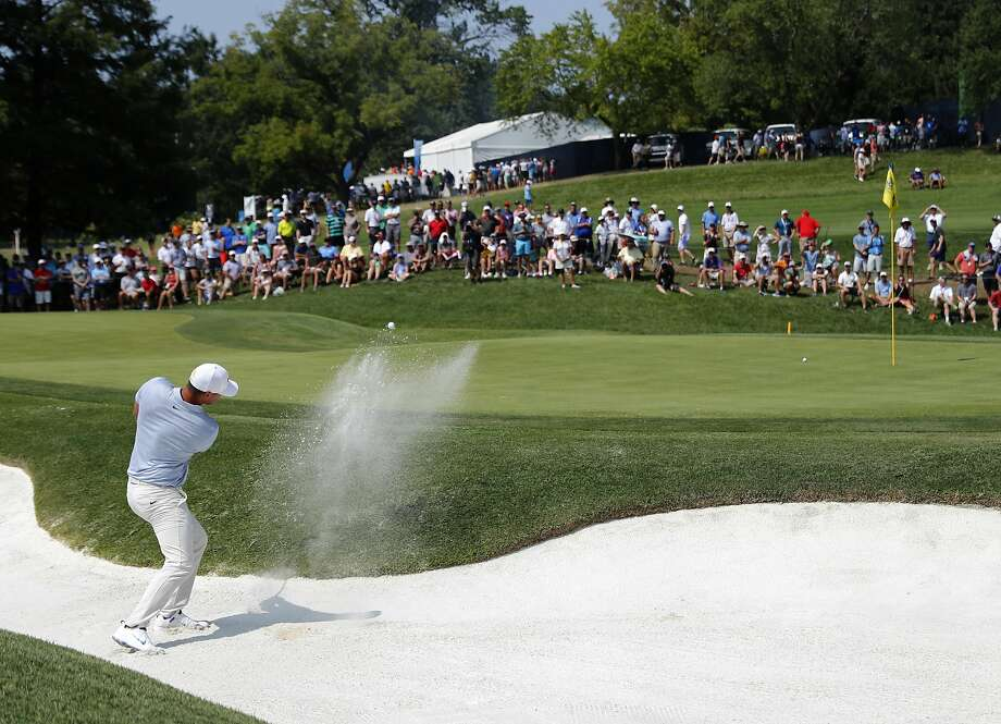 Brooks Koepka hits out of a bunker on the sixth hole during a third round that he played at 4 under to take the lead of the PGA Championship at Bellerive Country Club in St. Louis. Photo: Jeff Roberson / Associated Press