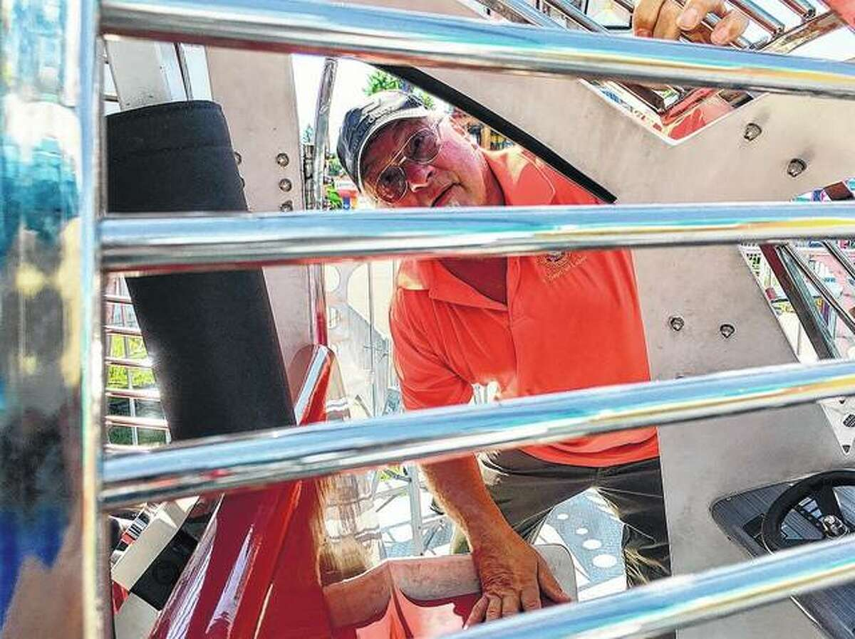 """FILE -Illinois Department of Labor amusement ride safety inspector Brian Brown inspects """"Charlie Chopper,"""" a ride in the midway of the Illinois State Fair in Springfield. John O'Connor 