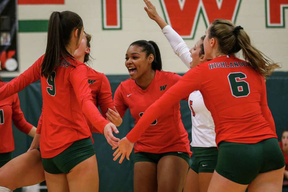 The Woodlands' Summer Jackson (15) celebrates with teammates during the volleyball game against College Station on Tuesday, Aug. 7, 2018, at The Woodlands High School. (Michael Minasi / Houston Chronicle) Photo: Michael Minasi, Staff Photographer / Houston Chronicle / © 2018 Houston Chronicle