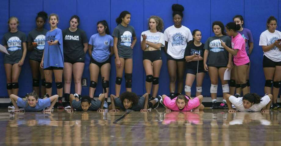 Hopeful Harlan High School volleyball players line up for a conditioning drill on the first day of volleyball tryouts Aug. 1, 2018. Photo: Josie Norris, Staff / San Antonio Express-News / © San Antonio Express-News