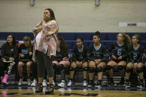 From the sidlines Coach Monica Gonzales nervously watches her team on the court at the first Harlan varsity volleyball game at Paul Taylor Fieldhouse Aug. 7, 2018.