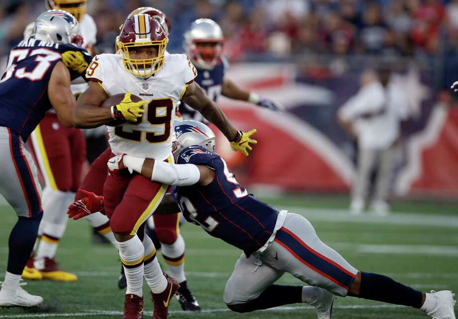 New England Patriots linebacker Elandon Roberts (52) tackles Washington Redskins running back Derrius Guice (29) during the first half of a preseason NFL football game, Thursday, Aug. 9, 2018, in Foxborough, Mass. (AP Photo/Charles Krupa) Photo: Charles Krupa / Copyright 2018 The Associated Press. All rights reserved